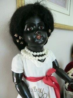 Antique ebony black doll 21 inch, mystery amazing
