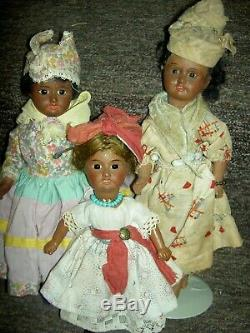Charming antique, BROWN bisque doll, sgnd. UNIS 60 FRANCE jointed withglass eyes