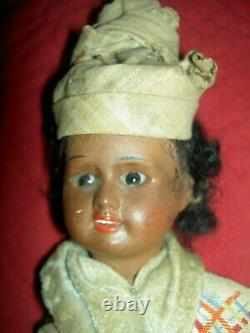 Pretty antique, BROWN bisque, signed UNIS 60 FRANCE, jointed doll withglass eyes