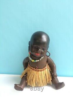 South Seas Baby Antique German, Brown Bisque Jointed Doll with Glass Eyes Orig